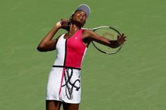 MASON, OH - AUGUST 17: Venus Williams serves against Samantha Stosur of Australia during day seven of the Western & Southern Open at Lindner Family Tennis Center on August 17, 2012 in Mason, Ohio.  (Photo by Nick Laham/Getty Images)
