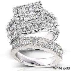 @Overstock - Demonstrate your love and commitment when you give this lovely diamond bridal ring set as a gift to the object of your affection. The set features six princess-cut diamonds set in 14-karat gold, creating a stunning appearance sure to impress.http://www.overstock.com/Jewelry-Watches/14k-Gold-2-4-5ct-TDW-Diamond-Halo-Bridal-Ring-Set/7009727/product.html?CID=214117 $2,999.99