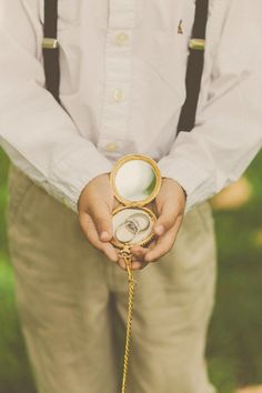A lovely touch to a vintage wedding, this pocket watch ring bearer box is an elegant way to present the rings at the altar. However, there's no clock inside to keep time for your marriage. We all know that this love is forever. | 11 Fun Ring Bearer Boxes, Pillows, and More