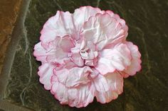 This Peony is one of the prettiest DIY flowers I've ever seen, and it's so simple. List of punches you can use to create, or you can even cut them out of half-folded paper if you don't have the punches (since they get scrunched anyway) AND they're made of cheap paper. Tutorial by SIMPLY PAPER: Peony Flower Tutorial