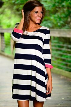 This dress is adorable!! The sea inspired navy and white stripes with the pop of coral... FABULOUS! Not to mention the amazing flowy fit!