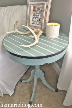 I love the serene blue color.  Beautiful end table done in chalk paint.