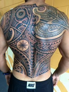 Polynesian style freehand back tattoo