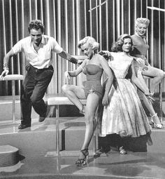 Richard Burton, Marilyn Monroe, Lauren Bacall and Betty Grable on the set of Gentlemen Prefer Blondes