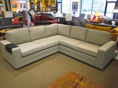 Inspirations 3 piece sectional by Palliser.  Shown here w/ small tambour table in espresso.
