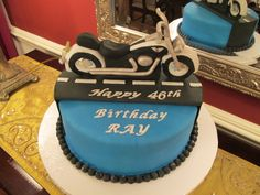 """I made this cake for my husband's birthday. He recently got a motorcycle. When I asked him what type of cake he wanted he answered """" a motorcycle of course"""". So here it is. The bike is made of Fondant and gumpaste."""