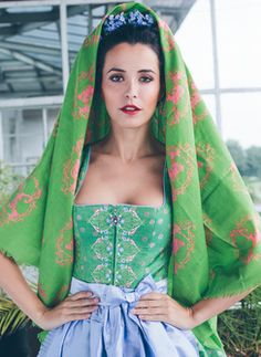 Traditional hairstyle with flowers and scarf.