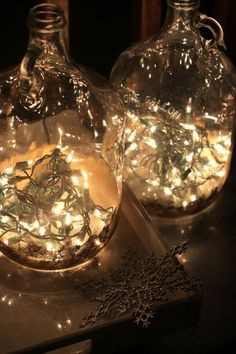 DIY Bottles of Light: Christmas lights add twinkle to apple juice bottles sprayed with gold paint / Design Mom Noel Christmas, Christmas Lights, Christmas Crafts, Christmas Decorations, Holiday Decor, Holiday Lights, Retro Christmas, Reception Decorations, Christmas Wedding