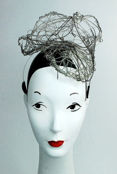 """Wired up"", sculpted wire headpiece as seen in beauNU Magazine Sept. 2015 Fabric & Lace issue. My mannequin is 21.5 inch headsize."