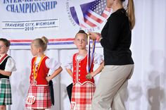 On the right - kilt with red vest #erskine #red #tartan  (she's ready for her medal ;-) )