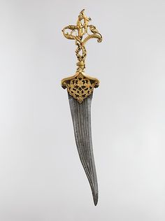 Dagger with Zoomorphic Hilt. Second half 16th century. India, Deccan, Bijapur or Golconda. Hilt: copper; cast, chased, gilded, and inlaid with rubies. Blade: steel; forged