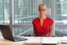 woman at desk stretch