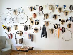 Usually I find heads-on-walls creepy, but these recycled bike trophies for hanging things up are kind of cool ~