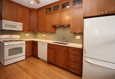 White and Cherry Wood Kitchen Remodel - contemporary - kitchen - chicago - Design Build 4U Chicago Wood with white looks terrible