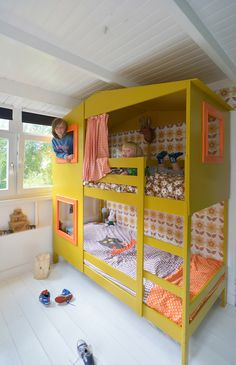 yellow IKEA hack house bunkbed for kids, via Rafa Kids