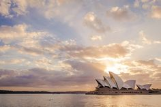 https://flic.kr/p/SqNovG | Sydney Opera House Sunrise | In our country(Chile) one of the most recognized milestones of Australia is the Sydney Opera House, so in our visit to Australia it was a must.  The Sydney Opera House is a beautiful building, probably photographed thousands or millions, but i had to have my version of the wonderful building. Wikipedia says that the forms was based in shells and i heard also that it was based on the form of the orange.  To take this picture i had to…