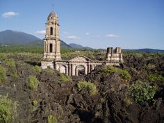 The Mexican church buried by lava : San Juan Parangaricutiro... This church is the only remaining building left from the village of San Juan Parangaricutiro, located in the state of Michoacán in Mexico. What happened? Not far from there In 1943 the Volcán de Parícutin started to rise out of a farmer's cornfield. In the following eruption, it buried 2 villages under lava and ashes, including San Juan Parangaricutiro.