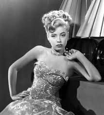This lovely woman is best known for her role as Aunt Bee in the Andy Griffith TV series. Her name was Francis Bavier. http://www.imdb.com/name/nm0062592/