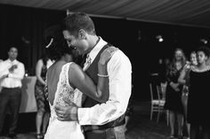 A cute moment captured during their first dance. | Powers Studios Photography | See more of this lovely garden wedding here: http://www.mywedding.com/articles/gabe-and-aracelis-traditional-garden-wedding-by-powers-photography-studios/