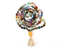 Handmade 108 Knotted Mala Beads - Multiple Stone Rudraksha TigersEye Pyrite Ruby Quartzite Jade Amethyst Hematite Beige Tassel Silver Buddha by arkaedesigns on Etsy