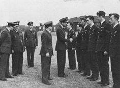 "A Royal Occasion. June 1941. Feltwell. The Duke of Kent meets NZ crews of 75 Squadron before the raid on Kiel. G/Cpt Maurice Buckley, Feltwell Station Commander, second from the left and W/Cdr Cyril Kay fourth from left. The Duke is shaking the hands with Bob Fotheringham. The Author is next to Fotheringham. Pip Coney is second from the right. From ""A Noble Chance"", by Maurice McGreal"