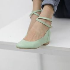 Mint green leather Ankle strap flats; really like these and would wear with jeans, skirts, capris, ankle pants.  Wonder if they come in other colors?