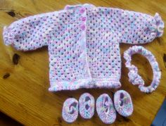 I've just made this Set for our new granddaughter, and am pleased with the way they turned out. I got the Jacket design, as in the link. The Booties were from a pattern I've had for ages, but don't know where I got it from. The headband is something I just made up, using some elastic, and the same yarn as the rest of the set. I used this yarn to make them: http://www.redheart.com/yarn/anne-geddes-baby/rocking-horse