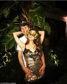 'New Years in Miami w the mami:' On New Year's Eve, he'd posted an Instagram photo in which he embraced her from behind as she beamed in a gold sequined miniskirt