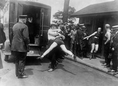 """ImageQuest #PhotoOfTheDay: """"A shocking crime."""" Women in 1920s Chicago being arrested for wearing one-piece bathing suits...without the required leg coverings. #WomensHistoryMonth stories you can tell with ImageQuest for #WomensDay. Margaret Hamilton, Valentina Tereshkova, Women In History, World History, British History, History Pics, History Images, Ancient History, History Articles"""