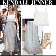 Kendall Jenner in white crop top, grey maxi skirt and metallic gladiator sandals