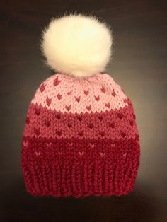 Pink Ombre Fair Isle knit hat with faux fur Pom, Knit ombre hat, perfect for Valentine's Day!! A personal favorite from my Etsy shop https://www.etsy.com/listing/502171991/fair-isle-knit-hat-knit-hat-with-faux