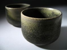 Ceramics by Stefan Andersson at Studiopottery.co.uk - Black cups with peaked base - Stoneware, sinter engobe, wood fired, unvarnished elm box. H: 6 cm, 2009.