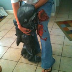 DIY shark victim costume using toilet paper. Elmer's glue, liquid foundation,& fake blood