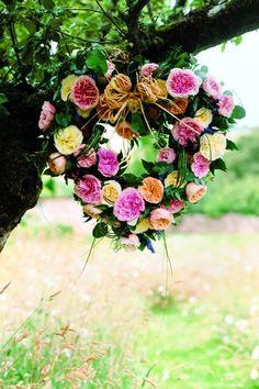 Heart-shaped wreath of Juliet, Rosalind, Patience and Miranda David Austin roses, marjoram, pittosporum, rosemary, eucalyptus, ruscus and lavender