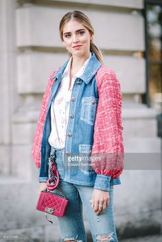 Chiara Ferragni is wearing blue denim jeans, a pink and blue denim jacket, and a pink Chanel bag, outside the Chanel show, during Paris Fashion Week Spring Summer 2017, at Grand Palais, on October 4, 2016 in Paris, France.