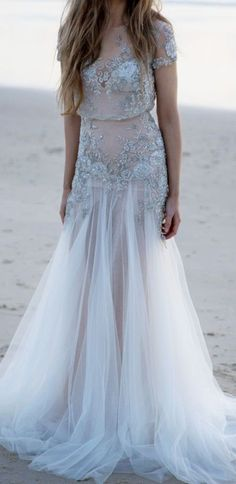 Glamorous silver embroidered beach wedding dress with tulle skirt; Featured Dress: Inbal Dror