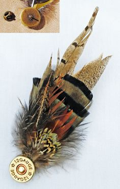 What a creative and gorgeous idea. it's a Feather Pin with Shotgun Shell. She has so many other beautiful pieces too, which are available at her online. Ammo Crafts, Bullet Crafts, Feather Hat, Feather Jewelry, Boutonnieres, Shotgun Shell Boutonniere, Shotgun Shell Crafts, Shotgun Shells, Shotgun Cartridges