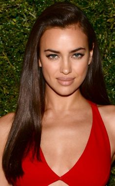 Russian Model Irina Shayk looks flawless with her gorgeous long sedu brown hair swept to one side framing her beautiful face just perfectly.