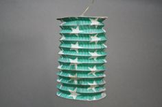 old french paper candle lantern - chinese lantern - white stars on a green background