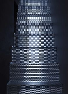 Perforated metal stairs. IS / Yo Yamagata Architects