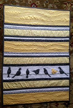 Beautiful bird quilt - I could see this done with red cardinals and black and white fabric too!