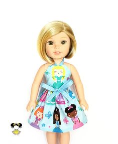 Magical and fun in this princess doll dress, perfect for the Wellie Wishers! The dress features a yellow hair princess print on a blue background with a blue ribbon tie. Item was handcrafted in our pet free, smoke free sewing studio. • Listing includes – 1 Halter dress ( yellow hair /