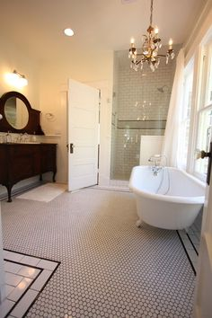I can pull a lot of ideas from this traditional bathroom: the dresser-sink, the tub, the commercial floor, the chandelier, the shower. 1920 Craftsman Rehab in Houston Heights Historic District
