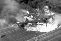 Pilot escapes his burning Grumman Hellcat after landing aboard the USS Lexington, 1945