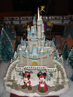 Disney Village Cinderella Castle miniature from Walt Disney World shown with Mickey and Minnie figures from Department 56 Disney Christmas Village, Mickey Mouse Christmas, Peanuts Christmas, Christmas Village Display, Christmas Town, Christmas Villages, Mickey Minnie Mouse, Christmas Holidays, Christmas Skirt