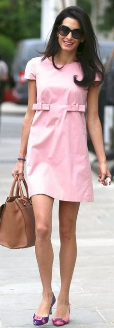 Purple bow pumps, pink short sleeve dress, sunglasses, and brown handbag