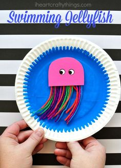 Kids will love making this fun paper plate swimming jellyfish craft that they can make swim around. Fun ocean crafts for kids and summer kids crafts.