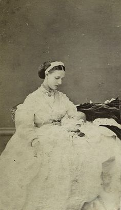 Pss Alexandra of Wales with her newborn son, Prince George, later duke of York and King George V of Great Britain.