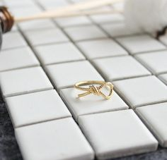 24 Gold plated stacking bow ring