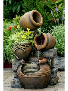 The Potted Water Fountain With Planter is the perfect corner water feature for any space. Featuring multiple tiers of falling water and an adorable little planter for your favorite flowers or greens.